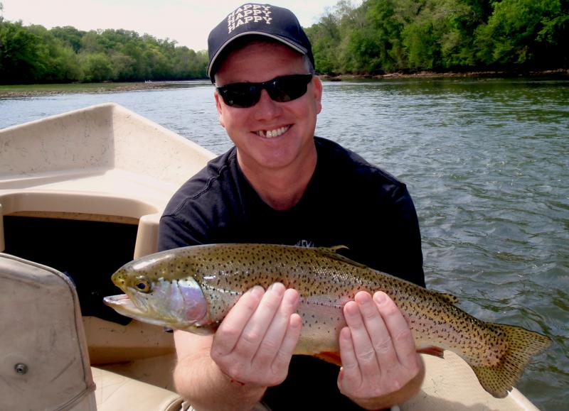 New fly fishermen catches trophy rainbow trout on a guided expedition in TN.