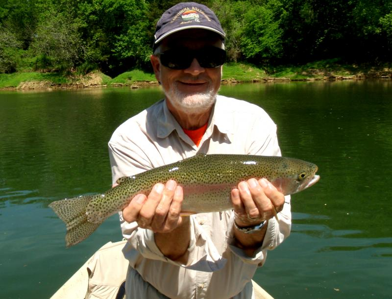 "Fly fishermen catches trophy rainbow trout with Michael "" Rocky"" Cox of RTA"