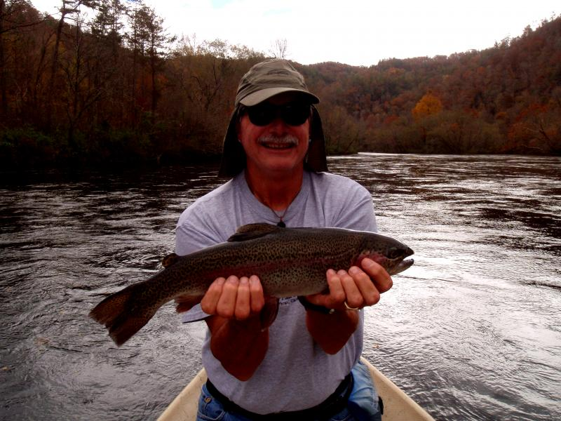 Jeff Jones catches a nice trout with fly fishing guide Rocky Cox