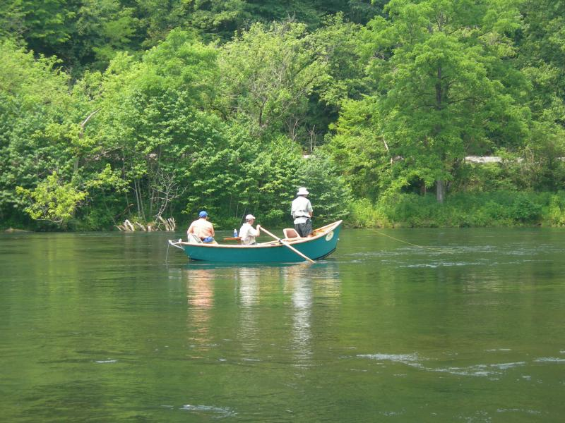 Great Hiwassee Fishing Guide Tony Wilson Working his wooden driftboat Rocky Top