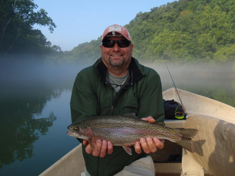 Early morning rainbow trout in the fog.